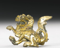7. a small gilt-bronze lion northern wei dynasty