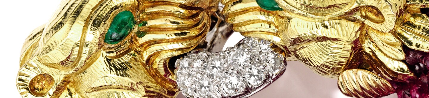 A David Webb bracelet with gold lions and diamonds in an auction selling David Webb jewelry