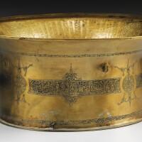 13. a monumental mamluk brass basin, syria or egypt, 14th century
