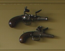 3. two small inlaid and engraved steel muff pistols, england, circa 1810