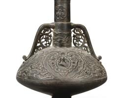 23. a 19th century pierced bronze vasein the hispano-moorish taste |