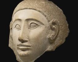 2. an indurated limestone mask, probably phoenician, circa 2nd/1st century b.c.
