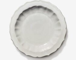 109. a small incised tianbai-glazed barbed dish ming dynasty, yongle period |