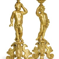11. a pair of dutch baroque carved giltwood torchères, in the manner of daniel marot circa 1700, the tops later