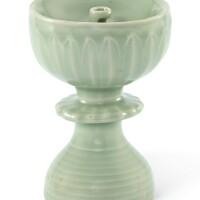 311. a rare longquan celadon 'lotus' oil lamp song dynasty |