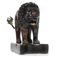 21. a bronze mounted carved and stained walnut lion-shaped lemon press, probably italian 17th / 18th century