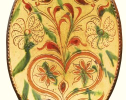 501. rare and important oval sgraffito glazed red earthenware dish with flowers and heart, attributed to conrad mumbouer (1761-1845) or john monday (1809-1862) haycock township, bucks county, pennsylvania, 1835-1845