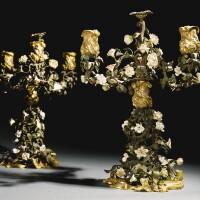 40. a pair of louis xv gilt-bronze, tôle and soft-paste porcelain three-light candelabra, circa 1745,