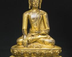 709. a gilt-bronze seated figure depictingshakyamuni buddha tibet, 15th century