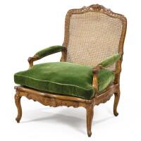 38. a french régence carved beechwood caned armchair, circa 1720  