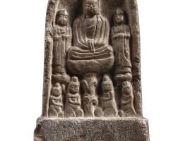 3113. an inscribed limestone 'buddhist triad' votive stele wuzhou dynasty dated 696 |