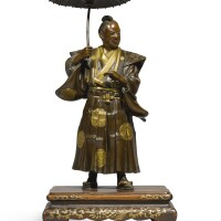 476. bronze inlaid figure of a man with umbrella meiji period, late 19th century | bronze inlaid figure of a dignitary with umbrellla