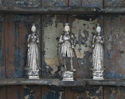 703. three german silver figures, of a knight in armour and two queens, ludwig neresheimer & co, hanau, importer's mark of thomas cook & son ltd, london, 1926