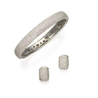 513. 18 karat white gold and diamond bangle-bracelet and earrings, breuning