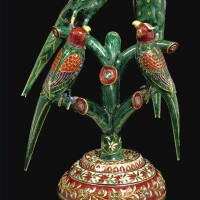 273. four gold and polychrome enamelled parrots perched on a branch, north india, 19th century