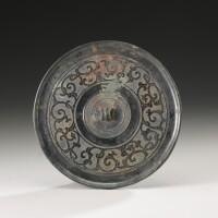 1. a bronze 'dragon' mirror warring states period