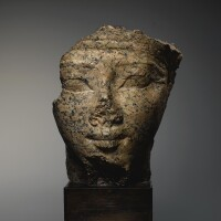 4. an egyptian red granite head of a man or god, 18th dynasty, early in the reign of tuthmosis iii, circa 1479-1450 b.c.