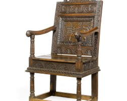 14. a charles i carved oak open armchair
