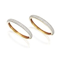 18. pair of 14 karat gold and diamond bangle-bracelets