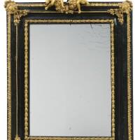 22. an italiangilt-bronze mounted ebony frame with mirror, late 17th/early 18thcentury  