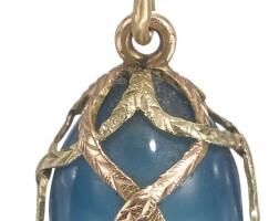 442. a gold-mounted hardstone egg pendant, circa 1900