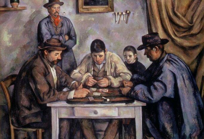 Three men sitting at a table playing cards with a man and boy in the background