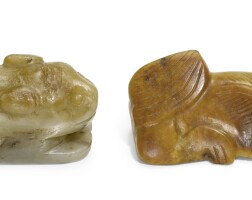 212. two carved jade lions