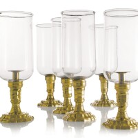 25. a set of four brass and glass photophores