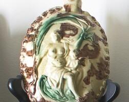 33. staffordshire lead-glazed cream-colored earthenwareoval flask circa 1765
