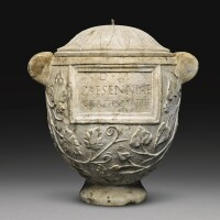 34. a roman marble cinerary urn inscribed for caesennia grapte, julio-claudian, 1st half of the 1st century a.d., with 18th century lid   a roman marble cinerary urn inscribed for caesennia grapte