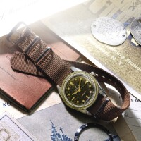 250. 勞力士(rolex) | 6204型號「submariner」精鋼腕錶,年份約1953。