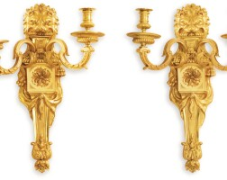 150. a pair of french gilt-bronze twin-light wall-lights |
