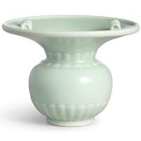 3617. a raremoulded celadon-glazed zhadou seal mark and period of yongzheng |