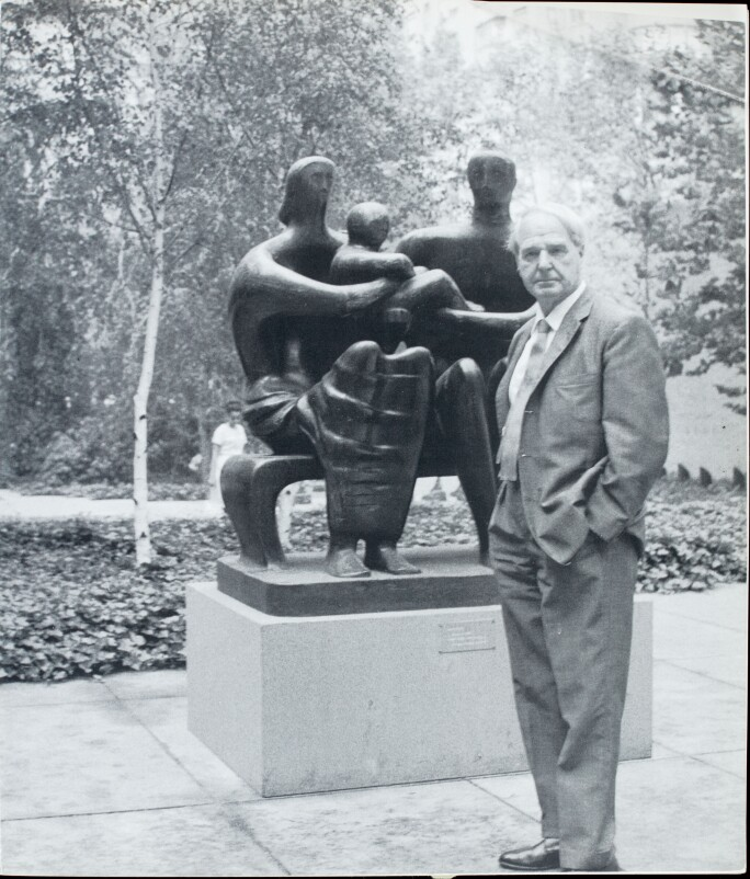 Henry Moore with Family Group, 1948-49, in the courtyard of the Museum of Modern Art