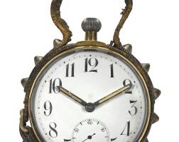 2505. déposé | a brass half spherical-form keyless table clockcirca 1940