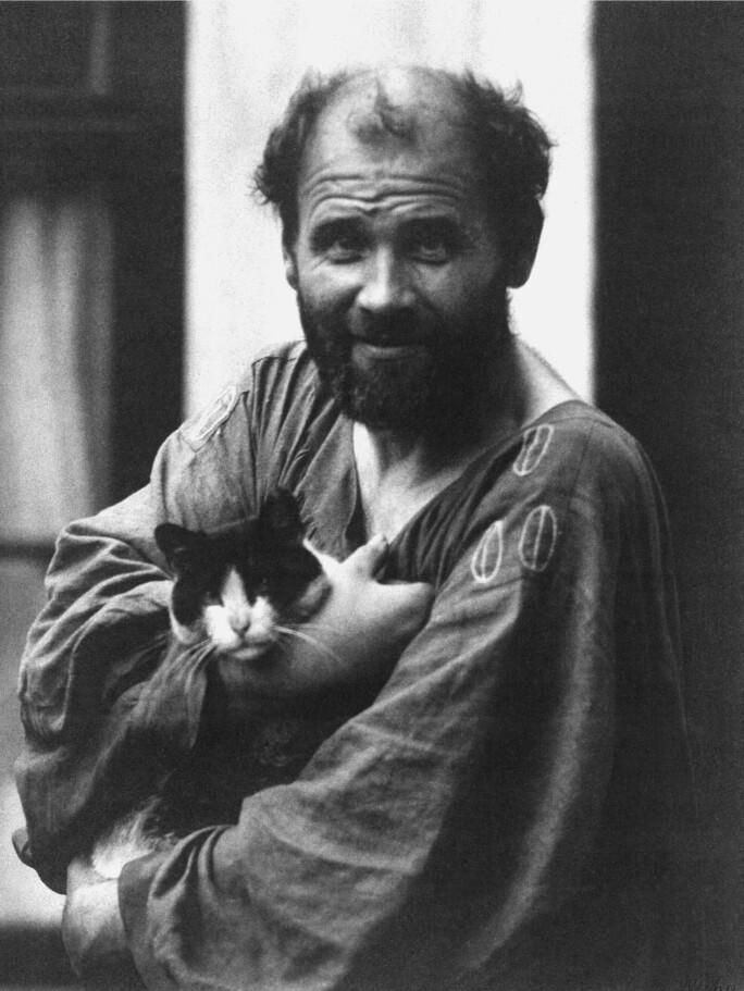 Gustav Klimt holding a cat.