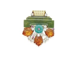 505. gold, platinum, hardstone, ruby and diamond clip-brooch, cartier