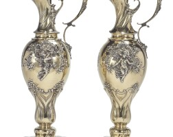 29. a pair of large american silver-gilt ewers, tiffany & co., new york, dated 1905  