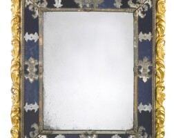 45. a venetian late baroque giltwood, blue and clear glass mirror