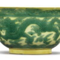 505. a yellow-ground green-enameled 'dragon' bowl kangxi mark and period