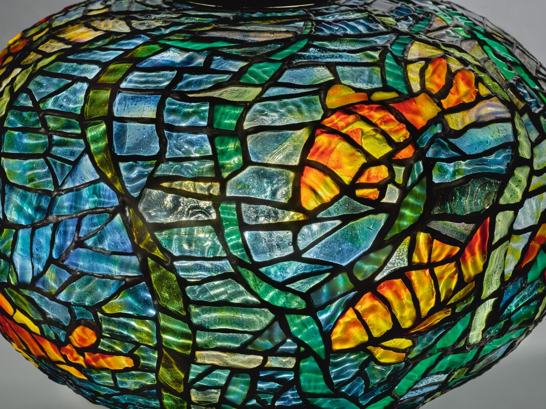 "Tiffany Studios, AN IMPORTANT AND RARE ""FISH AND WAVES"" TABLE LAMP, c. 1900-1903. Estimate $1,000,000–1,500,000."