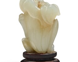 1211. a pale celadon jade carving of a magnolia qing dynasty, 18th / 19th century |