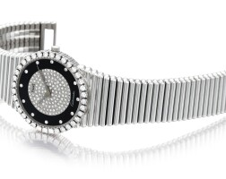 24. piaget   reference 12336 c10 a heavy white gold and diamond-set bracelet watch with onxy dial, made in 1977