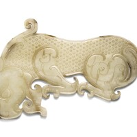 3620. an exceptional and large yellow jade animal-shaped plaque eastern zhou dynasty |
