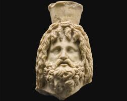 19. a roman marble head of sarapis, egypt, circa 1st century a.d. | a roman marble head of sarapis, egypt