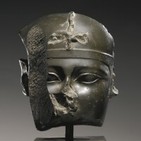 49. a fragmentary egyptian greywacke head of a king, second half of the 26th dynasty, circa 610-525 b.c.