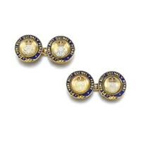 9. the pair of gold, tinted rock crystal intaglio and enamel cufflinks, english, circa 1915