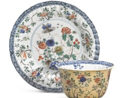 1507. a cafe-au-lait and wucai 'floral' cup and saucer qing dynasty, kangxi period |