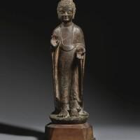 13. a limestone figure of a standing buddha eastern wei / northern zhou dynasty |