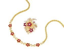 1604. ruby and diamond necklace and matching brooch